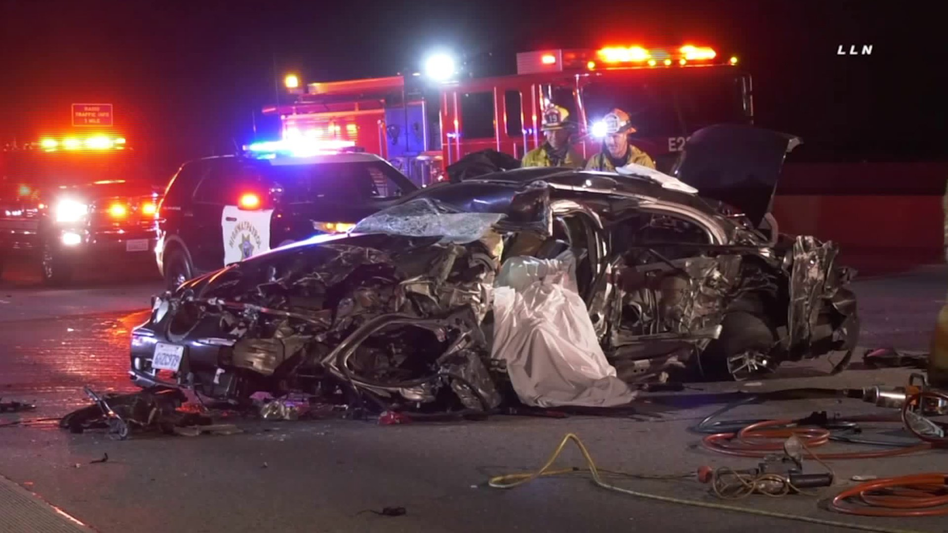 Authorities assess the scene of a deadly wrong-way crash on the 405 Freeway near Getty Center Drive on Feb. 16, 2020. (Credit: KTLA)