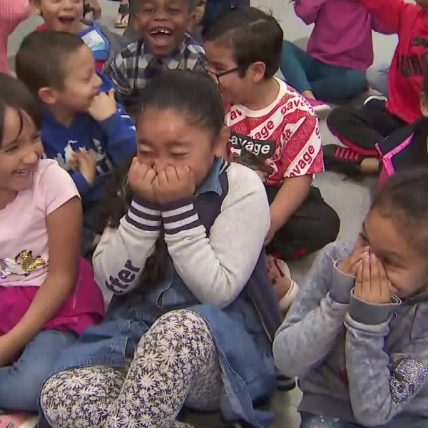 Inglewood first graders react to receiving free bicycles on Feb. 28, 2020. (KTLA)