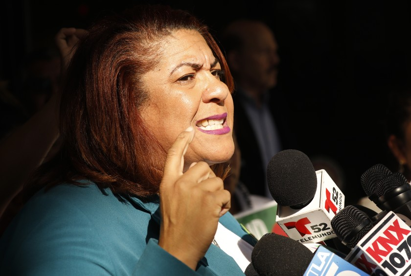 Cecily Myart-Cruz speaks during a 2019 news conference on union negotiations. (Al Seib / Los Angeles Times)