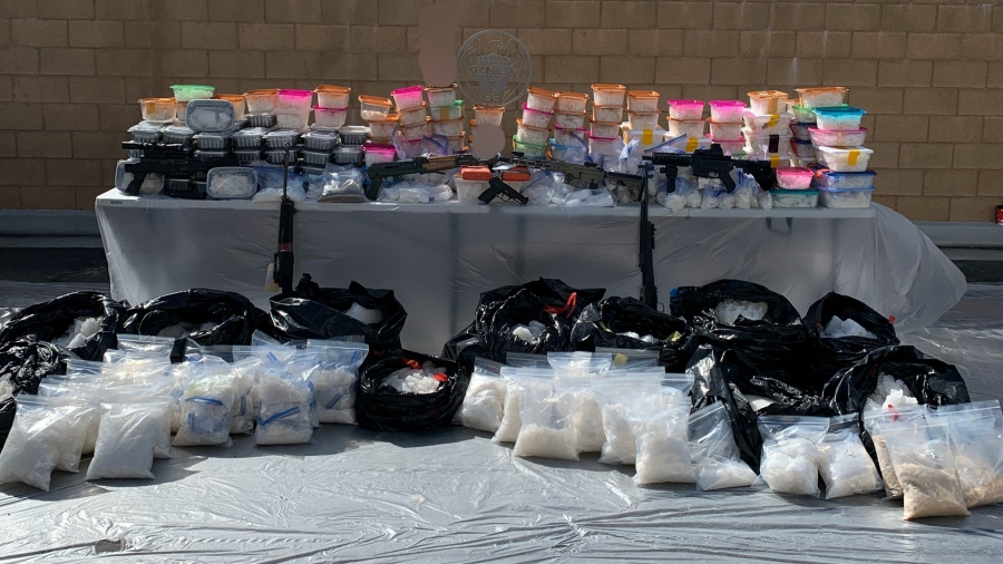 Law enforcement officials display drugs and guns seized during a bust in San Bernardino on Feb. 20, 2020. (Credit: U.S. Drug Enforcement Administration)