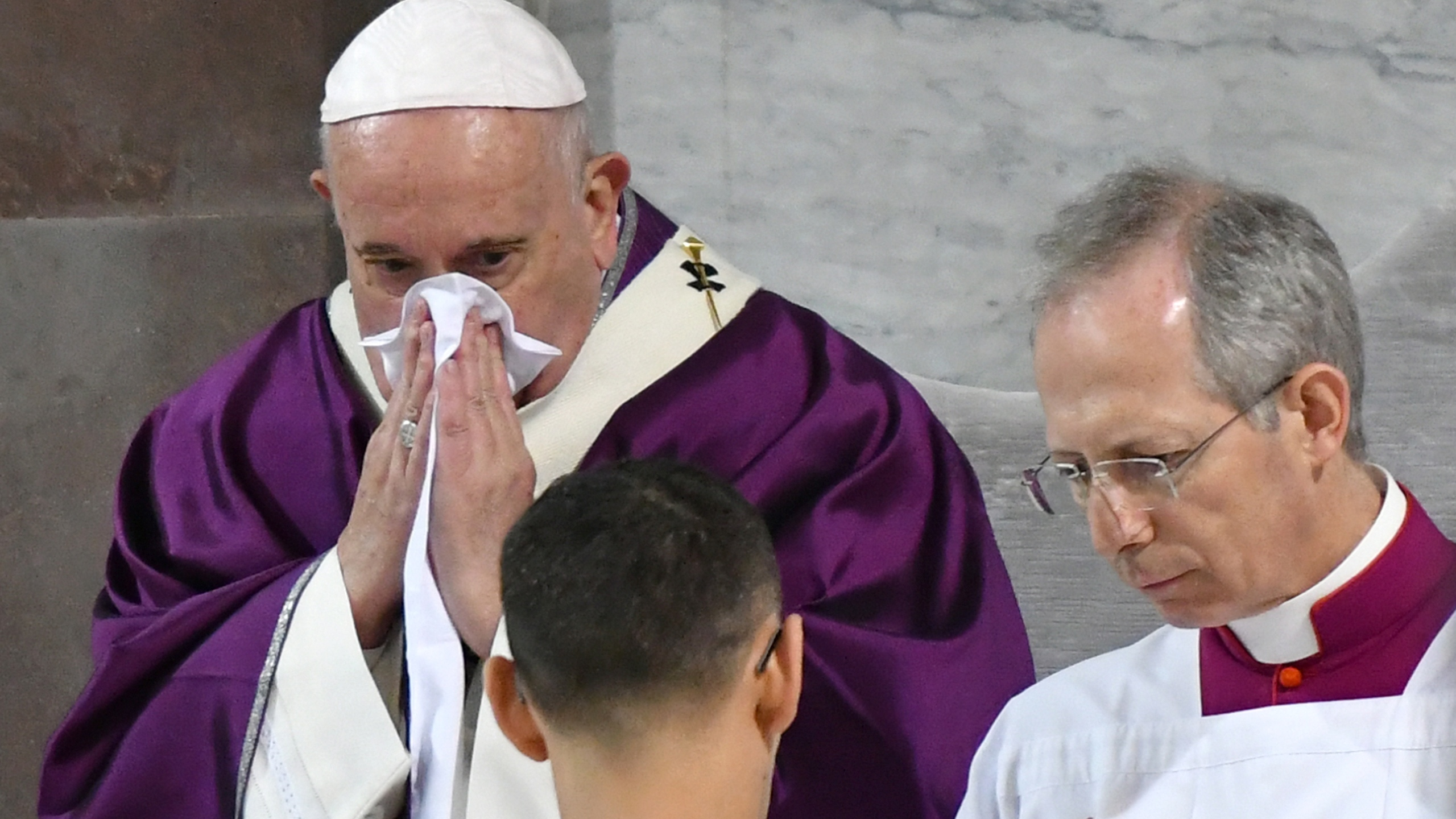 Pope Francis blows his nose as he leads the Ash Wednesday mass on February 26, 2020, at the Santa Sabina church in Rome. (ALBERTO PIZZOLI/AFP via Getty Images)