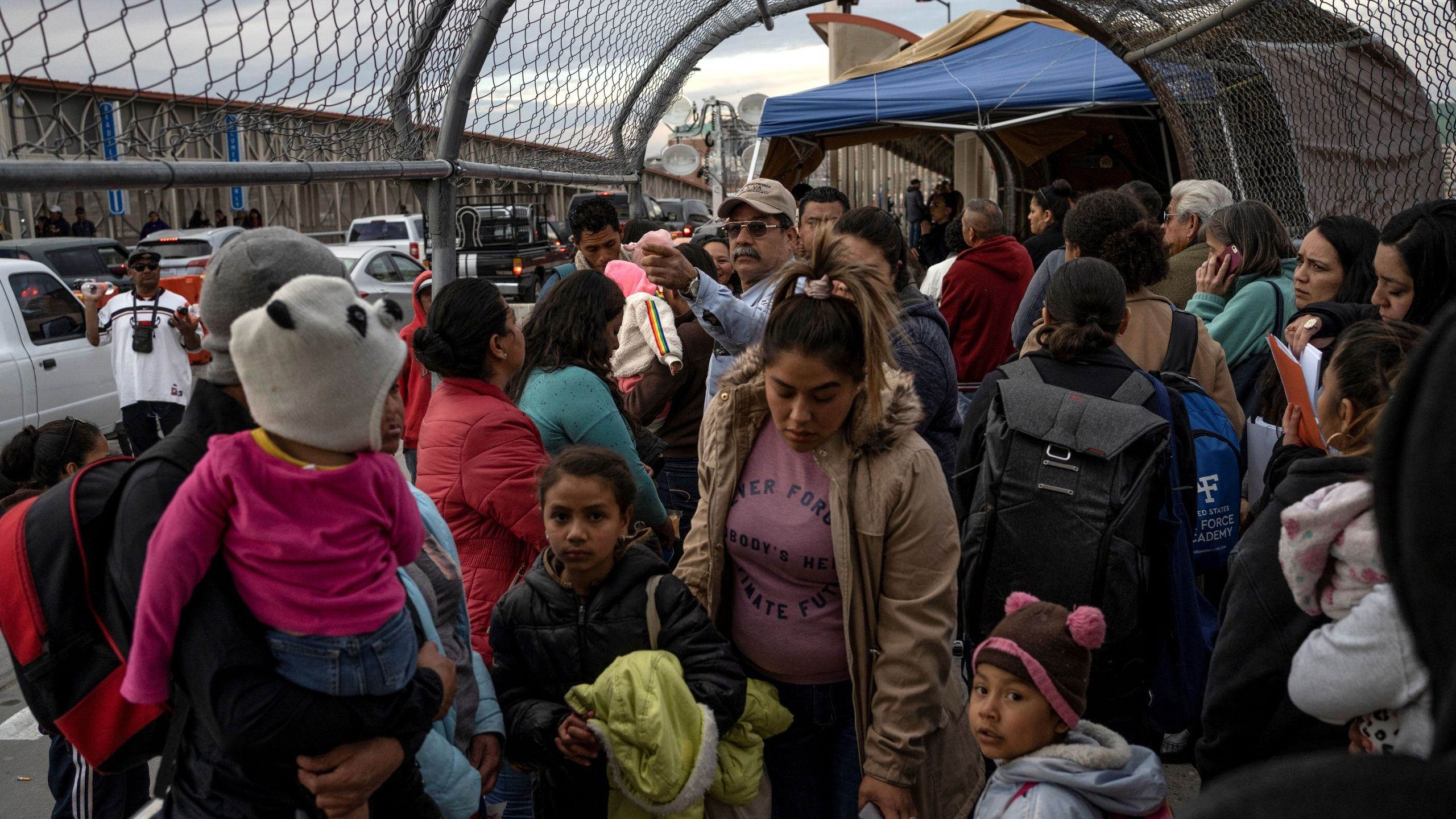 Migrants part of the Migrant Protection Protocols program are led back down Paso del Norte International Bridge after not being allowed to cross into the U.S. on February 28, 2020, in Ciudad Juárez. (PAUL RATJE/AFP via Getty Images)