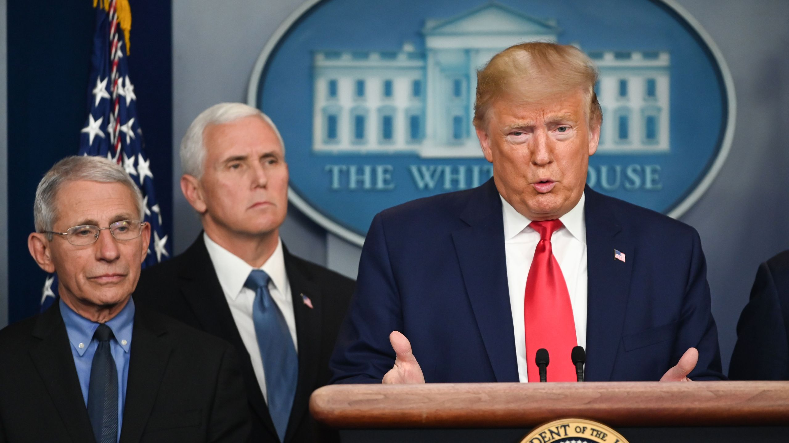 Donald Trump speaks during a press conference on the coronavirus outbreak as Anthony Fauci, director of the National Institute of Allergy and Infectious Diseases at the National Institutes of Health, and Vice President Mike Pence look on at the White House in Washington, D.C. on Feb. 29, 2020. (ROBERTO SCHMIDT/AFP via Getty Images)