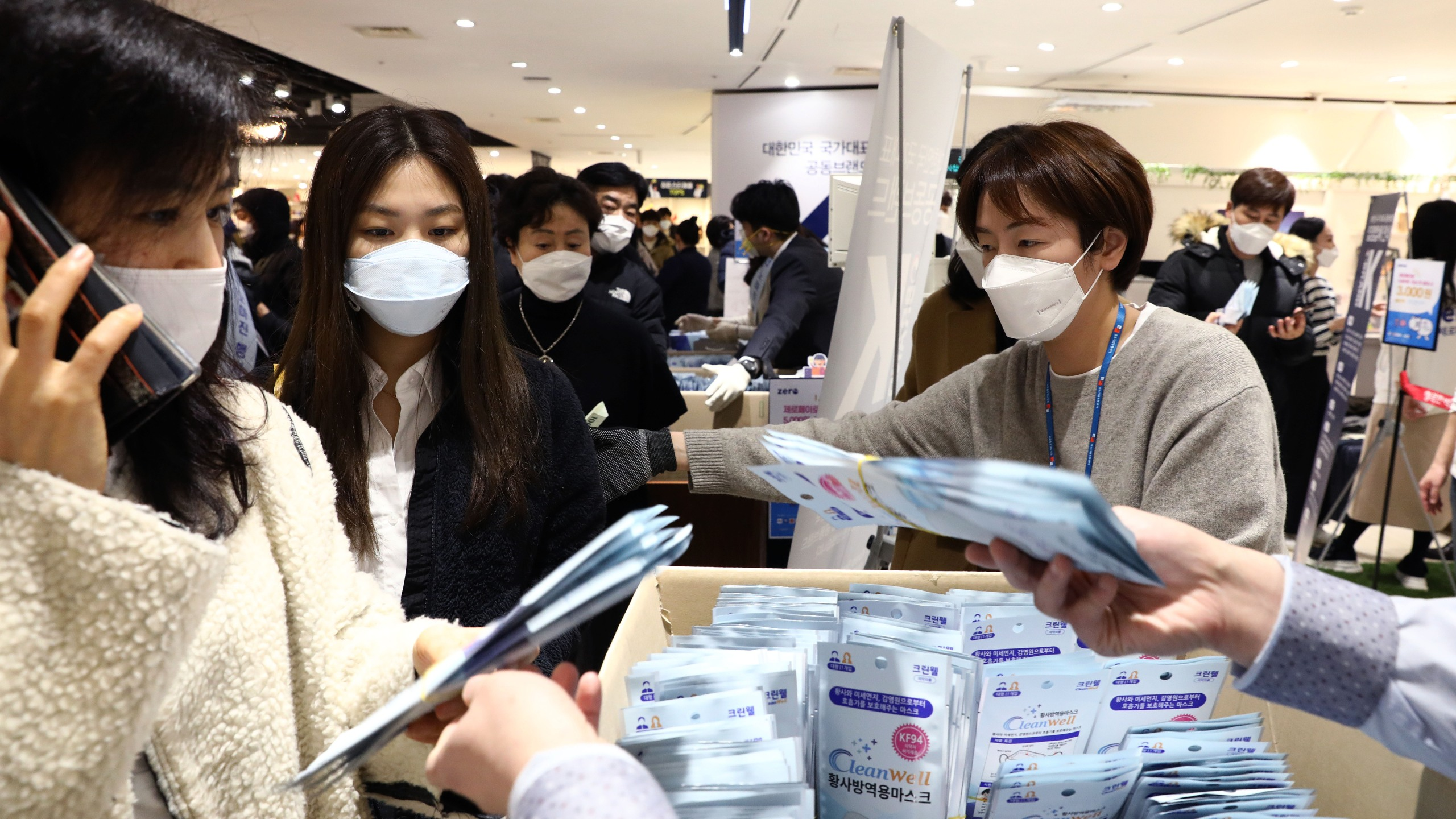 People wearing masks to prevent the coronavirus (COVID-19) buy face masks at a department store on February 28, 2020 in
