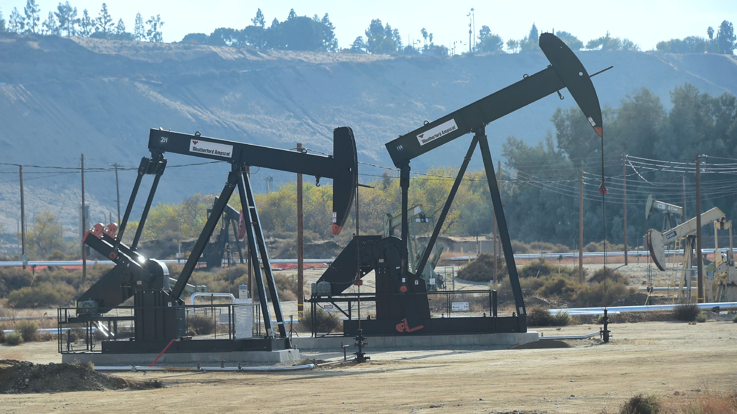 Oil derricks at the Chevron Oil Field in Bakersfield are seen on Nov. 21, 2016. (Credit: Frederic J. Brown / AFP / Getty Images)