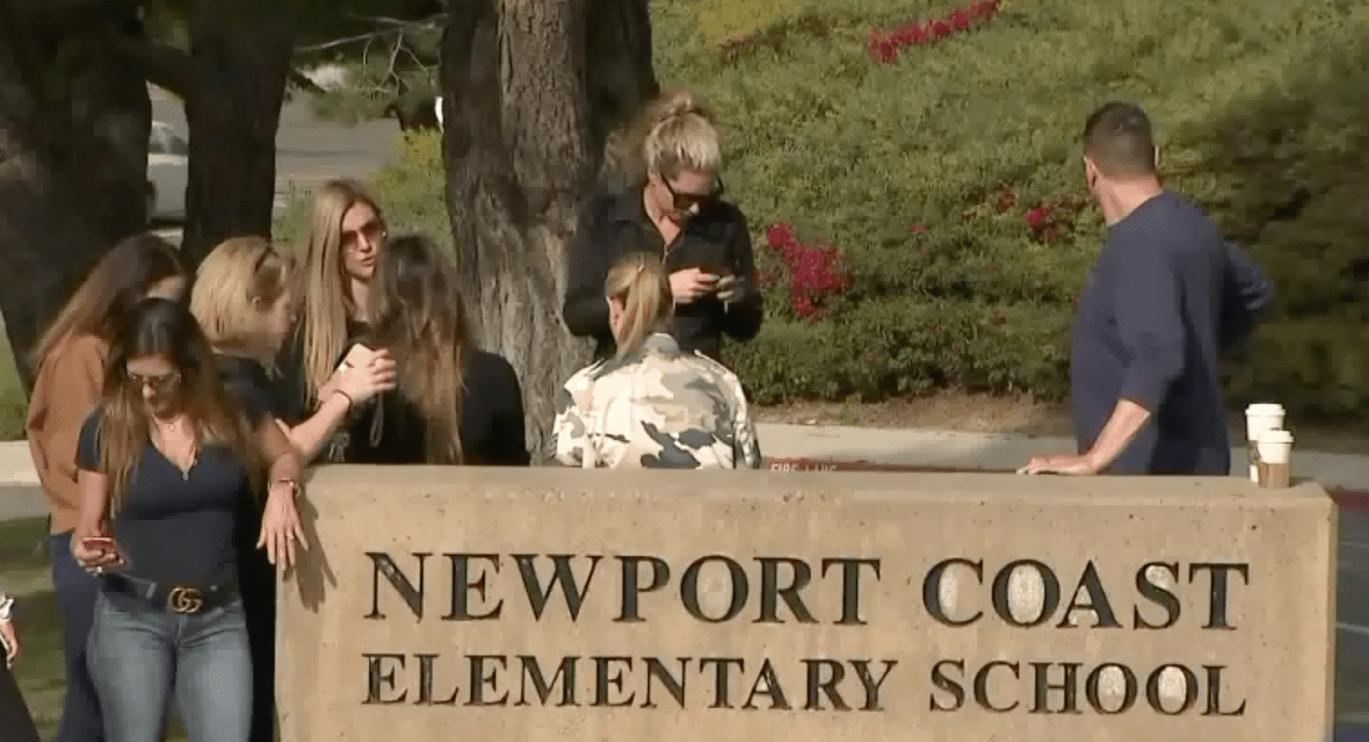 Concerned parents gather at Newport Coast Elementary on Feb. 28, 2020. (KTLA)