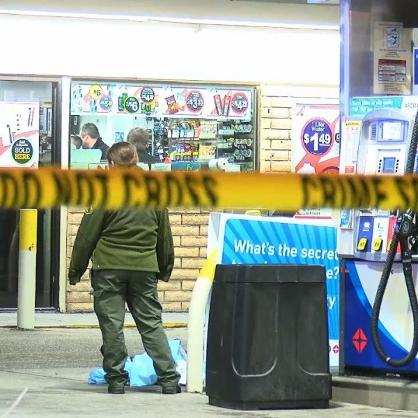 Officials respond to the scene where a man was fatally shot at an Arco gas station in Perris on Feb. 2, 2020. (Credit: LoudLabs)