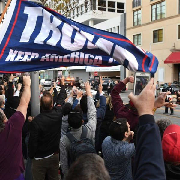 Trump supporters and protesters watch as the president arrives outside the Montage Hotel in Beverly Hills on Feb. 18, 2020.(Credit: Wally Skalij / Los Angeles Times)