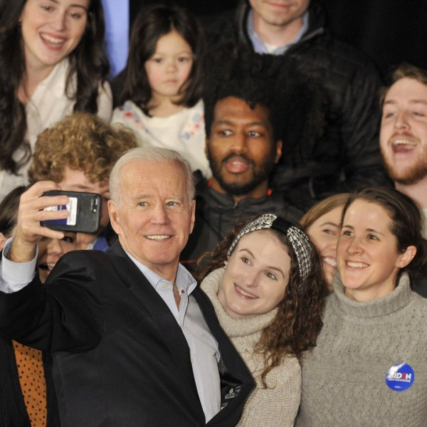 US Presidential Candidate and former Vice President Joe Biden takes selfies with supporters after speaking at a rally at the Rex Theatre in Manchester, New Hampshire on February 8, 2020. (Credit: Joseph Prezioso/ AFP/Getty Images)