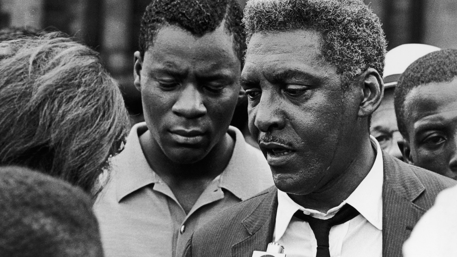 African American civil rights activist Bayard Rustin talks to a reporter during the Harlem Riots in Manhattan on July 23, 1964. (Credit: Express/Hulton Archive/Getty Images)