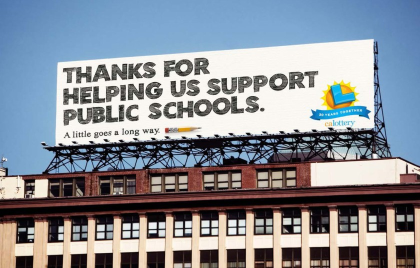 """An undated photo of a California Lottery billboard reads: """"Thanks for Helping Us Support Public Schools. A little goes a long way."""" (California Lottery via Los Angeles Times)"""