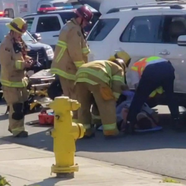 In footage provided to KTLA, a Fullerton college student is seen pinned underneath an SUV on Feb. 19, 2020.
