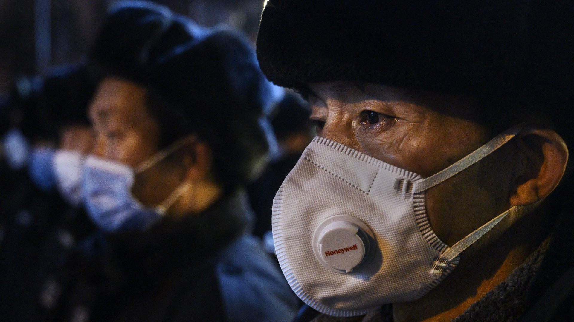 A Chinese security guard wears a protective mask as he lines up with others on February 9, 2020 in Beijing, China. (Credit: Kevin Frayer/Getty Images)