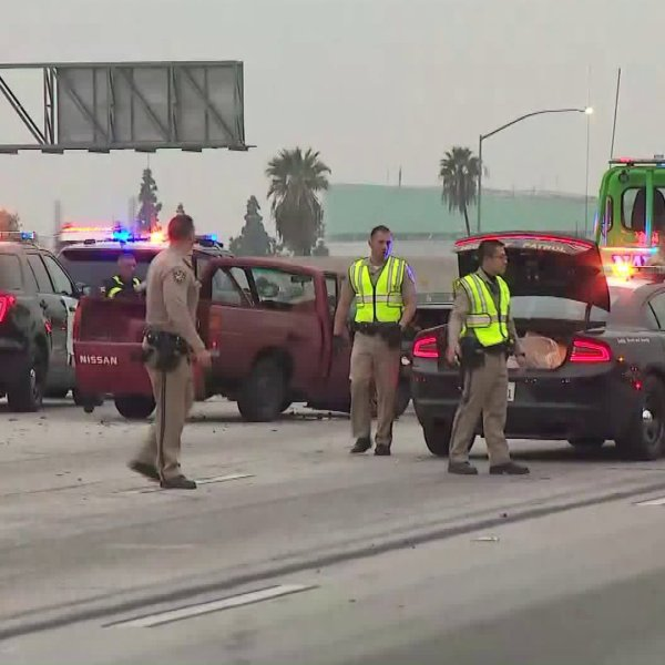 Officers respond toa deadly crash on the westbound 10 Freeway in the Baldwin Park area on Feb. 10, 2020. (Credit: KTLA)