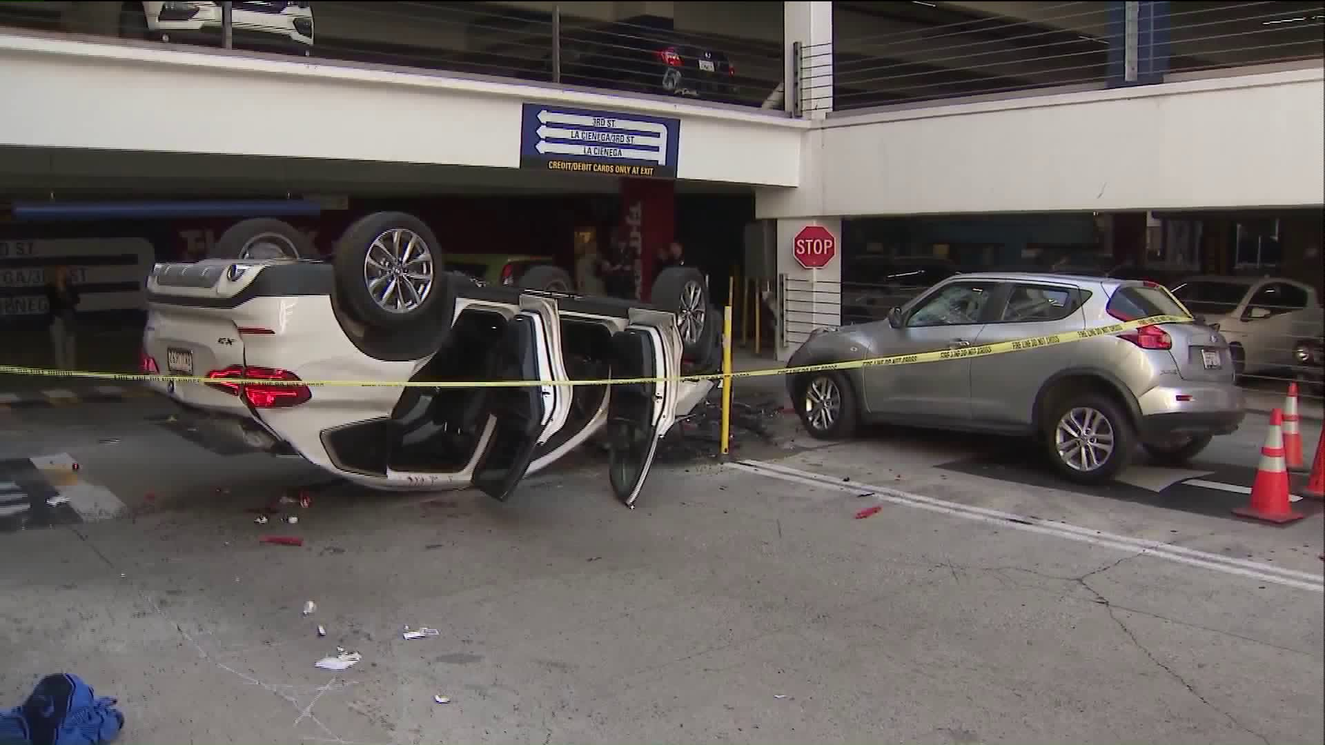 One person was hospitalized after an SUV plunged off the third floor of the Beverly Connection parking structure on Feb. 20, 2020. (Credit: KTLA)