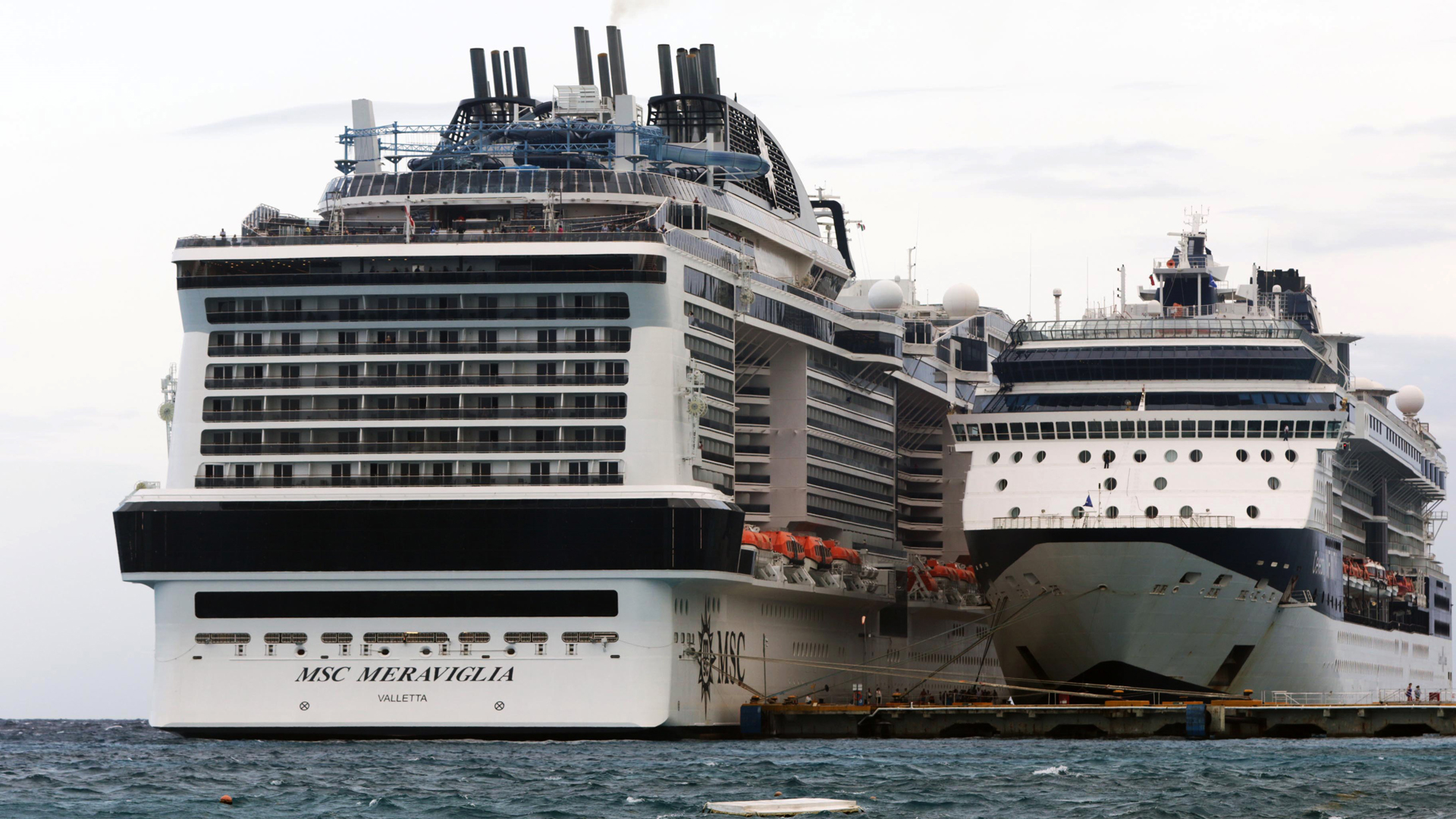 MSC Merviglia cruise ship, left, is seen in Cozumel, Mexico, on Feb. 27, 2020. (Credit: JOSE CASTILLO/AFP via Getty Images)