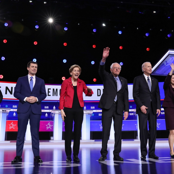 Democratic presidential hopefuls, from left, former New York Mayor Mike Bloomberg, former mayor of South Bend, Indiana, Pete Buttigieg, Sen. Elizabeth Warren, Sen. Bernie Sanders, former Vice President Joe Biden, Sen. Amy Klobuchar and billionaire activist Tom Steyer arrive to participate in the tenth Democratic primary debate in Charleston, South Carolina, on Feb. 25, 2020. (Credit: Logan Cyrus / AFP / Getty Images)