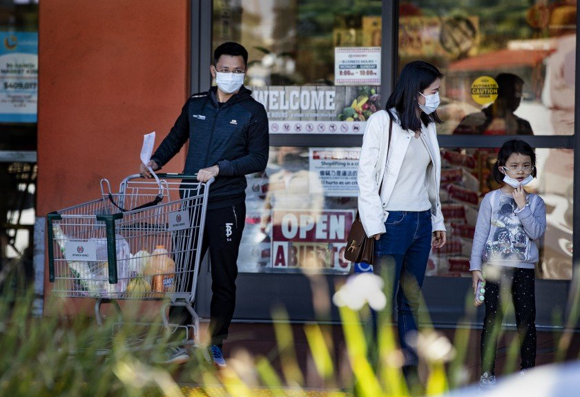 A woman and her family wear masks to shop at San Gabriel Square. They are visiting the U.S. from Shanghai for a month.(Credit: Gina Ferazzi / Los Angeles Times)