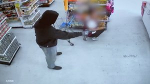 A gunman robbed the Dollar Max store, 3545 E. 1st Street in East Los Angeles, on Feb. 21, 2020, as pictured in this surveillance video obtained by KTLA.