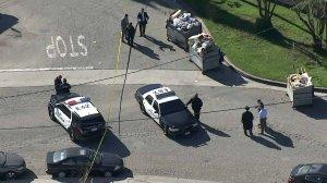 Detectives investigate a homicide scene in El Monte on Feb. 4, 2020. (Credit: KTLA)