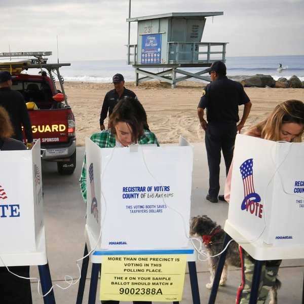 People vote near a Venice Beach lifeguard station on Nov. 6, 2018. (Credit: Mark Ralston /AFP / Getty Images)