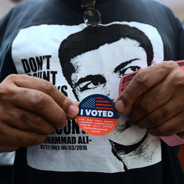 """A man displays his """"I Voted"""" sticker after voting in the library at the Midnight Mission in Skid Row, downtown Los Angeles, California on Nov. 6, 2018. (FREDERIC J. BROWN/AFP via Getty Images)"""