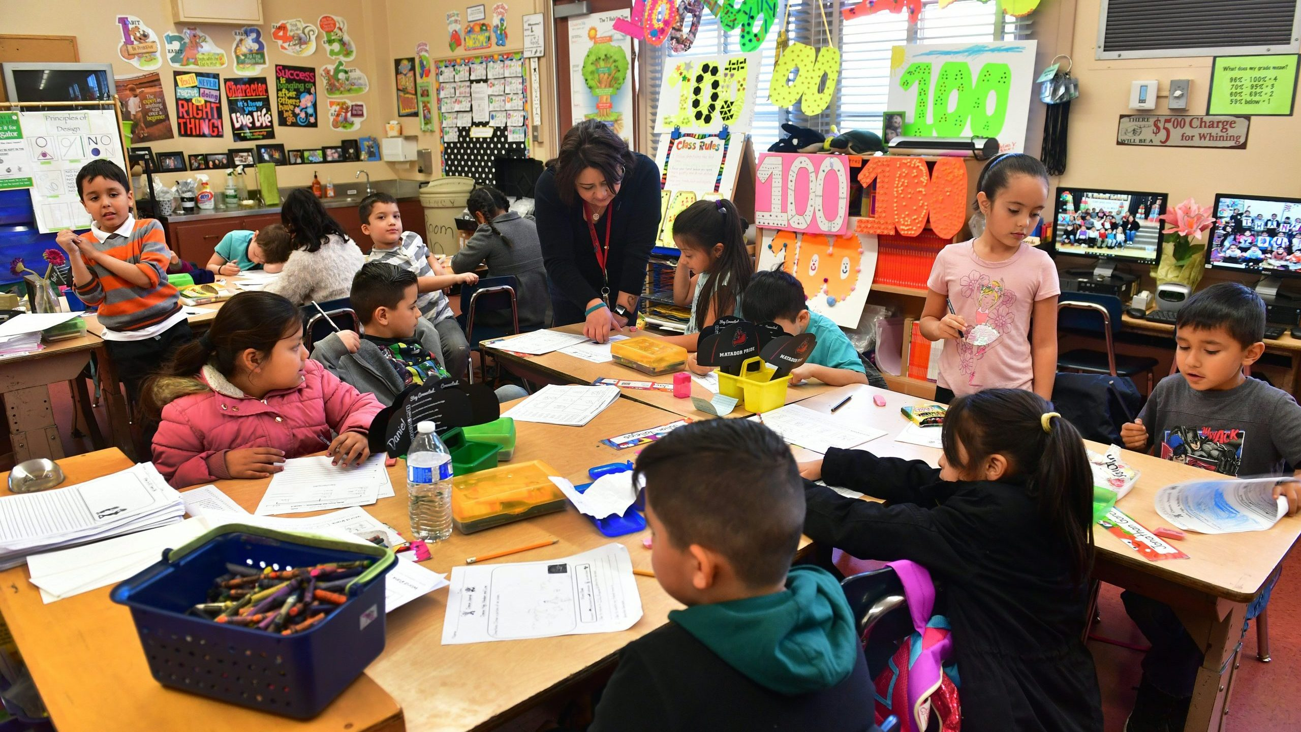 Telfair Elementary School first grade teacher Ms. Gutierrez works with her students on Feb. 8, 2019 in Pacoima. (Credit: FREDERIC J. BROWN/AFP via Getty Images)