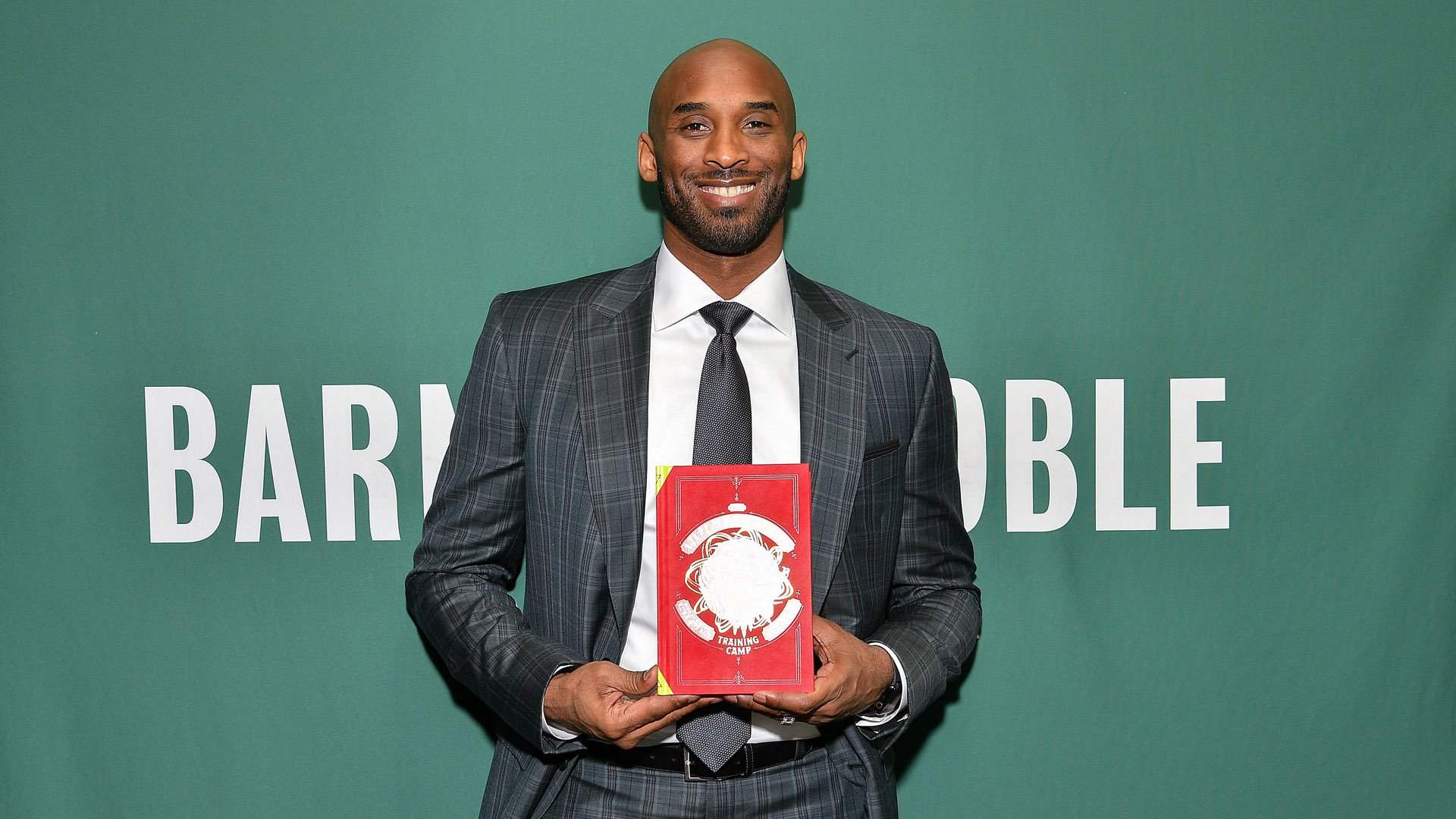 """Kobe Bryant promotes his book """"Training Camp (The Wizenard Series #1)"""" at Barnes & Noble Union Square on March 20, 2019, in New York City. (Credit: Dia Dipasupil/Getty Images for BN)"""