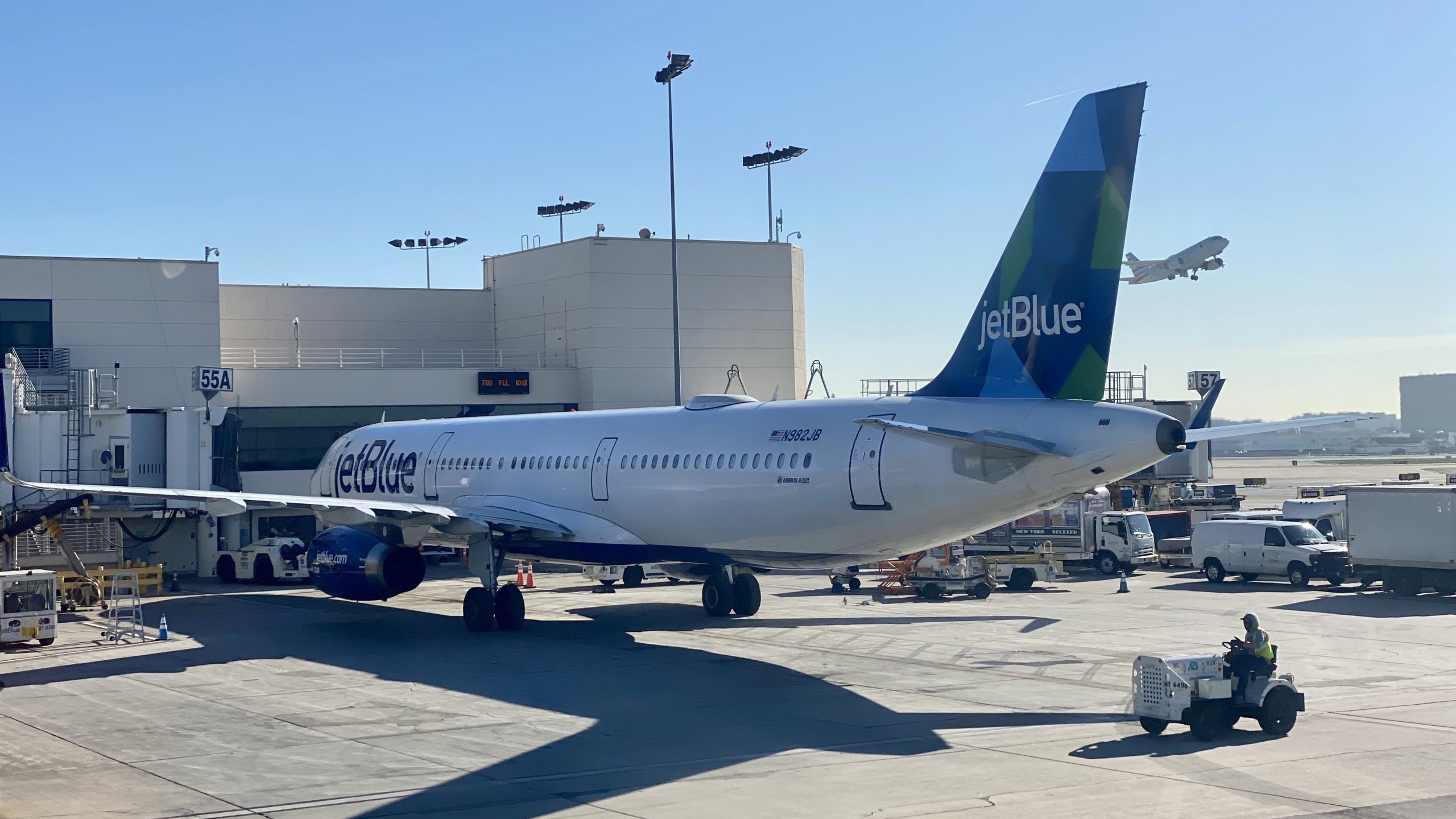 An Airbus 321 from the JetBlue airline company is seen at a gate at LAX on Jan. 6, 2020. (Credit: DANIEL SLIM/AFP via Getty Images)