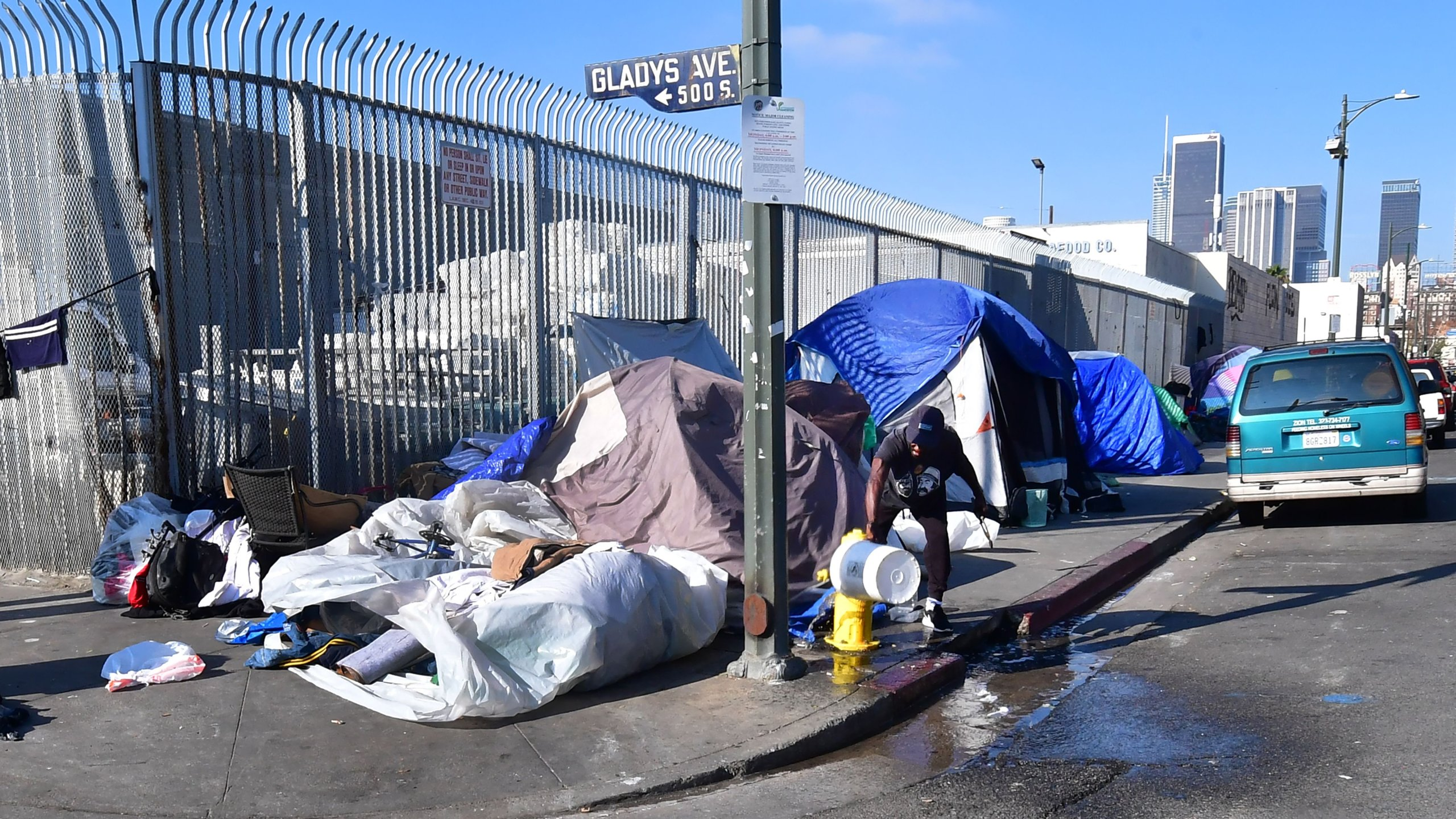 Tents of the homeless line a street corner in Los Angeles on Jan. 8, 2020. (Credit: Frederic J. Brown / AFP / Getty Images)
