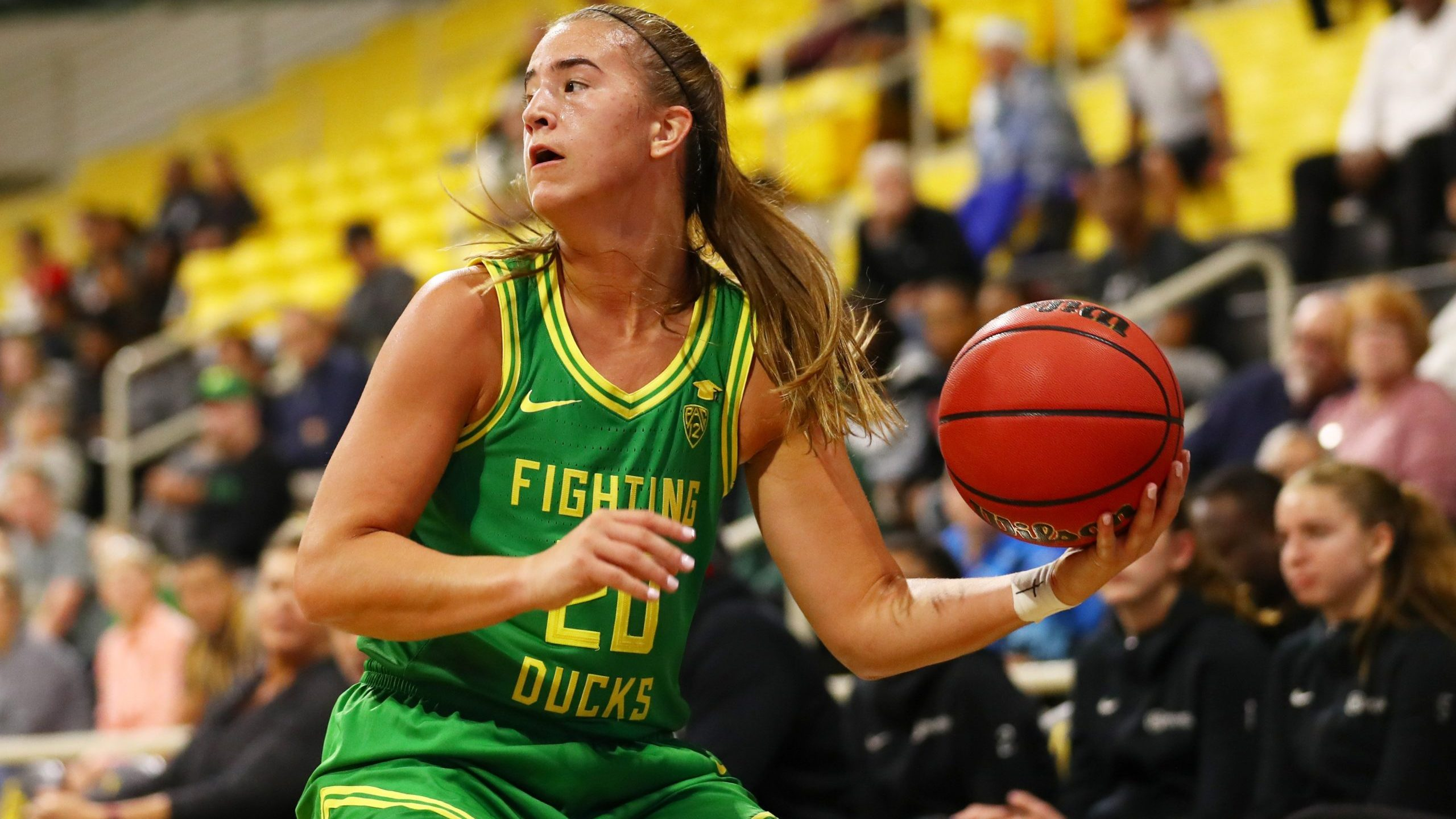 Sabrina Ionescu of the Oregon Ducks moves the ball during a game against Long Beach State at Walter Pyramid on Dec. 14, 2019. (Credit: Joe Scarnici / Getty Images)