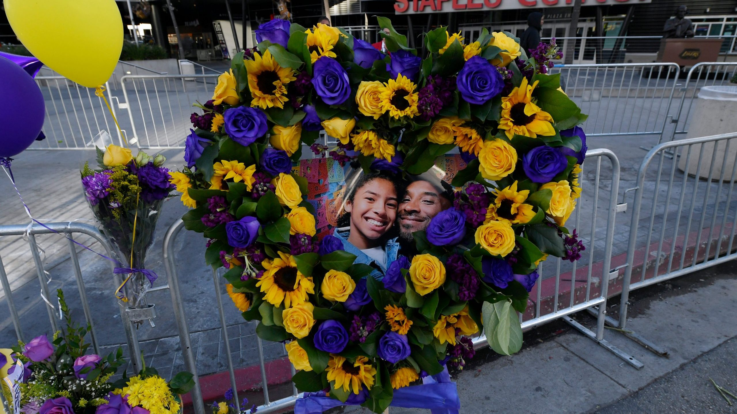 Fans continue to pay their respect to Kobe Bryant and his daughter Gianna, 13, at a memorial set up outside of Staples Center on January 28, 2020 in Los Angeles, California. (Credit: Kevork Djansezian/Getty Images)
