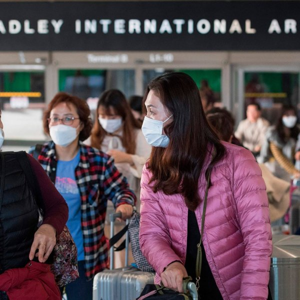 Passengers wear protective masks as they arrive at the Los Angeles International Airport, California, on Jan. 29, 2020.(Credit: Mark Ralston/AFP via Getty Images)