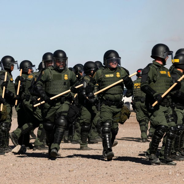 Border Patrol agents conduct a training exercise near the wall that divides Sunland Park, New Mexico, from Ciudad Juarez, Mexico, on Jan. 31, 2020. (Credit: Herika Martinez / AFP / Getty Images)