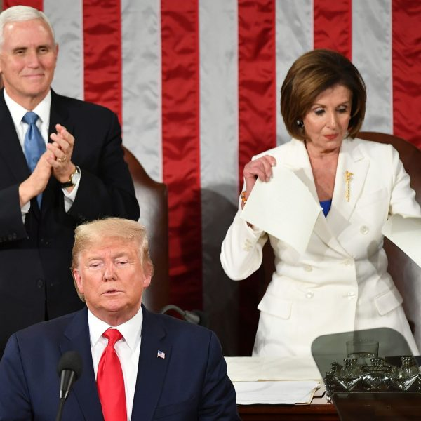 US Vice President Mike Pence claps as Speaker of the US House of Representatives Nancy Pelosi appears to rip a copy of US President Donald Trumps speech after he delivers the State of the Union address at the US Capitol in Washington, DC, on February 4, 2020. (Credit: MANDEL NGAN/AFP via Getty Images)