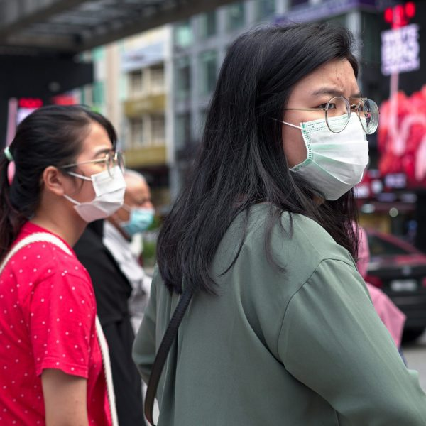 Visitors wearing masks wait at a traffic junction in Bukit Bintang district on Feb. 5, 2020, in Kuala Lumpur, Malaysia. The coronavirus, originating in Wuhan, China, has spread around the globe. (Credit: Ore Huiying/Getty Images)