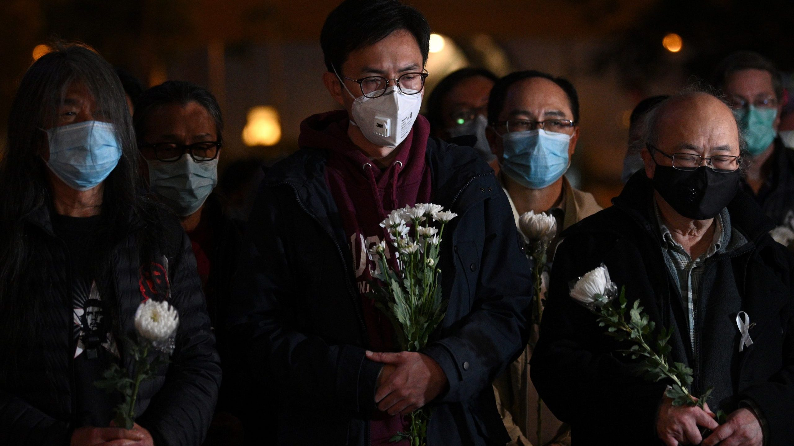 People attend a vigil in Hong Kong Feb. 7, 2020, for novel coronavirus whistleblowing doctor Li Wenliang, 34,who died in Wuhan after contracting the virus while treating a patient. (Credit: ANTHONY WALLACE/AFP via Getty Images)
