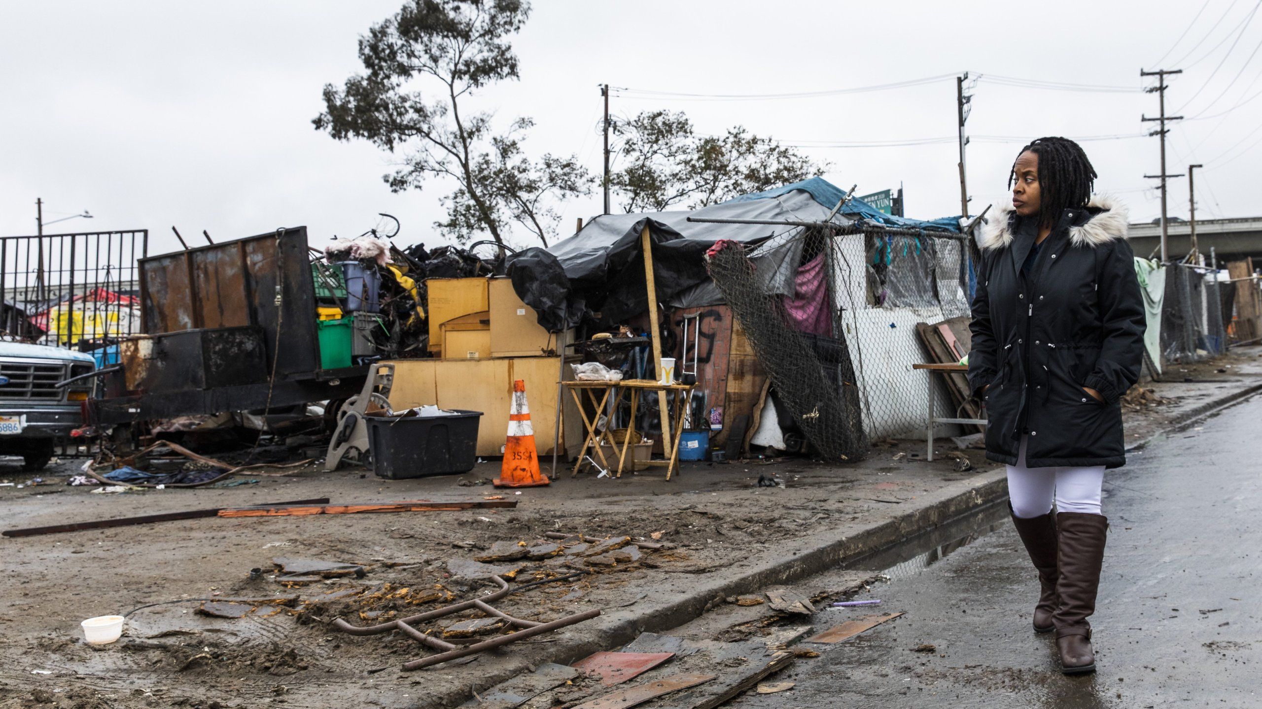 Carroll Fife, the director of the Oakland office for the Alliance of Californians for Community Empowerment, walks outside a homeless encampment in Oakland on Jan. 28, 2020. (Credit: Philip Pacheco / AFP / Getty Images)