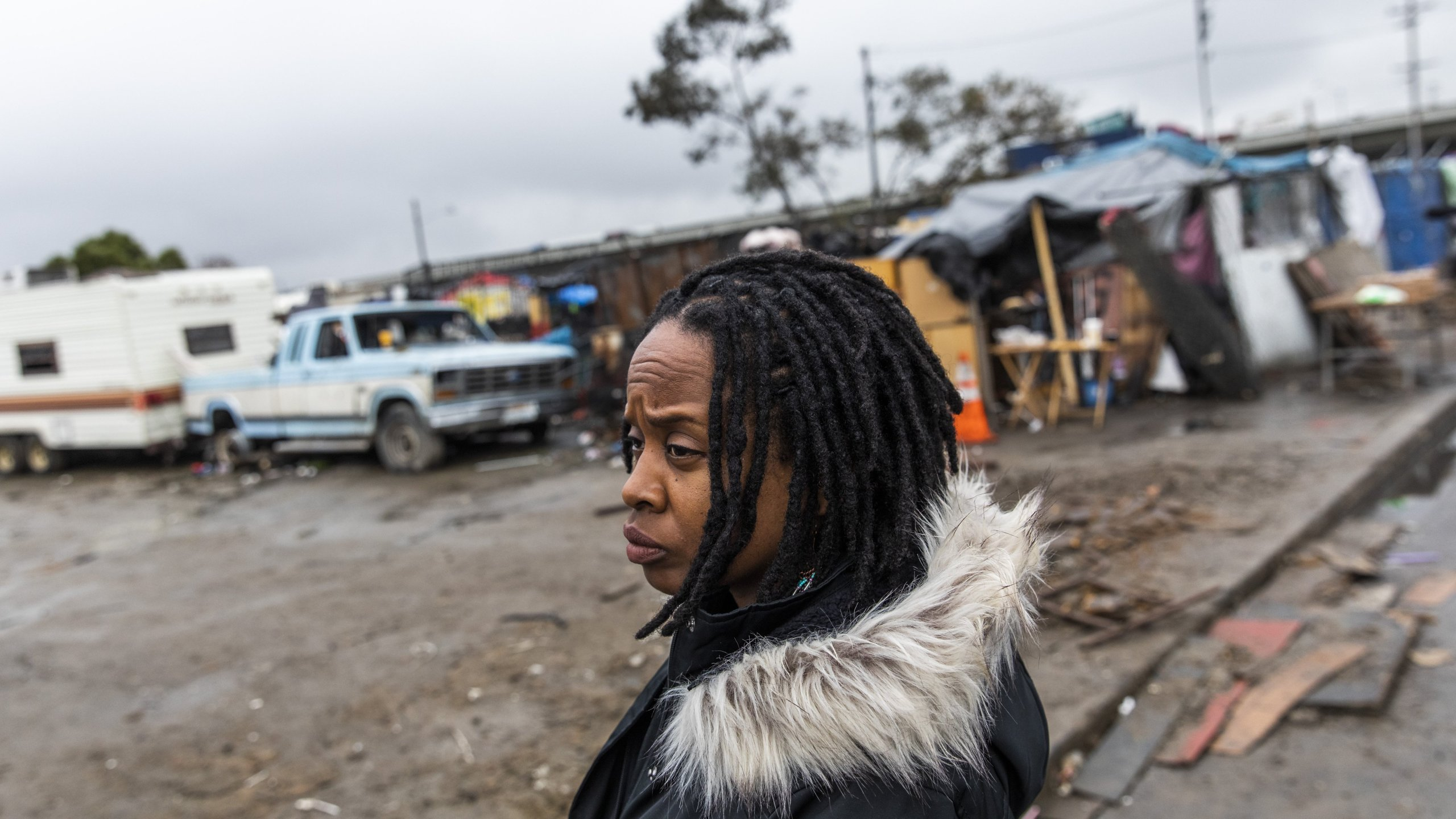 Carroll Fife, director of the Oakland office for the Alliance of Californians for Community Empowerment, stands outside a homeless encampment in Oakland on Jan. 28, 2020. (Credit: Philip Pacheco / AFP / Getty Images)