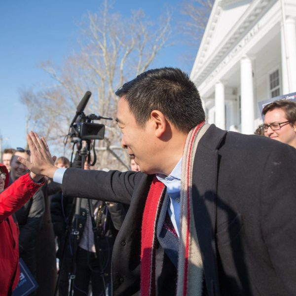 Democratic presidential candidate Andrew Yang high-fives a boy outside of Hopkinton Town Hall following a campaign event on Feb. 9, 2020, in New Hampshire. (Credit: Scott Eisen/Getty Images)