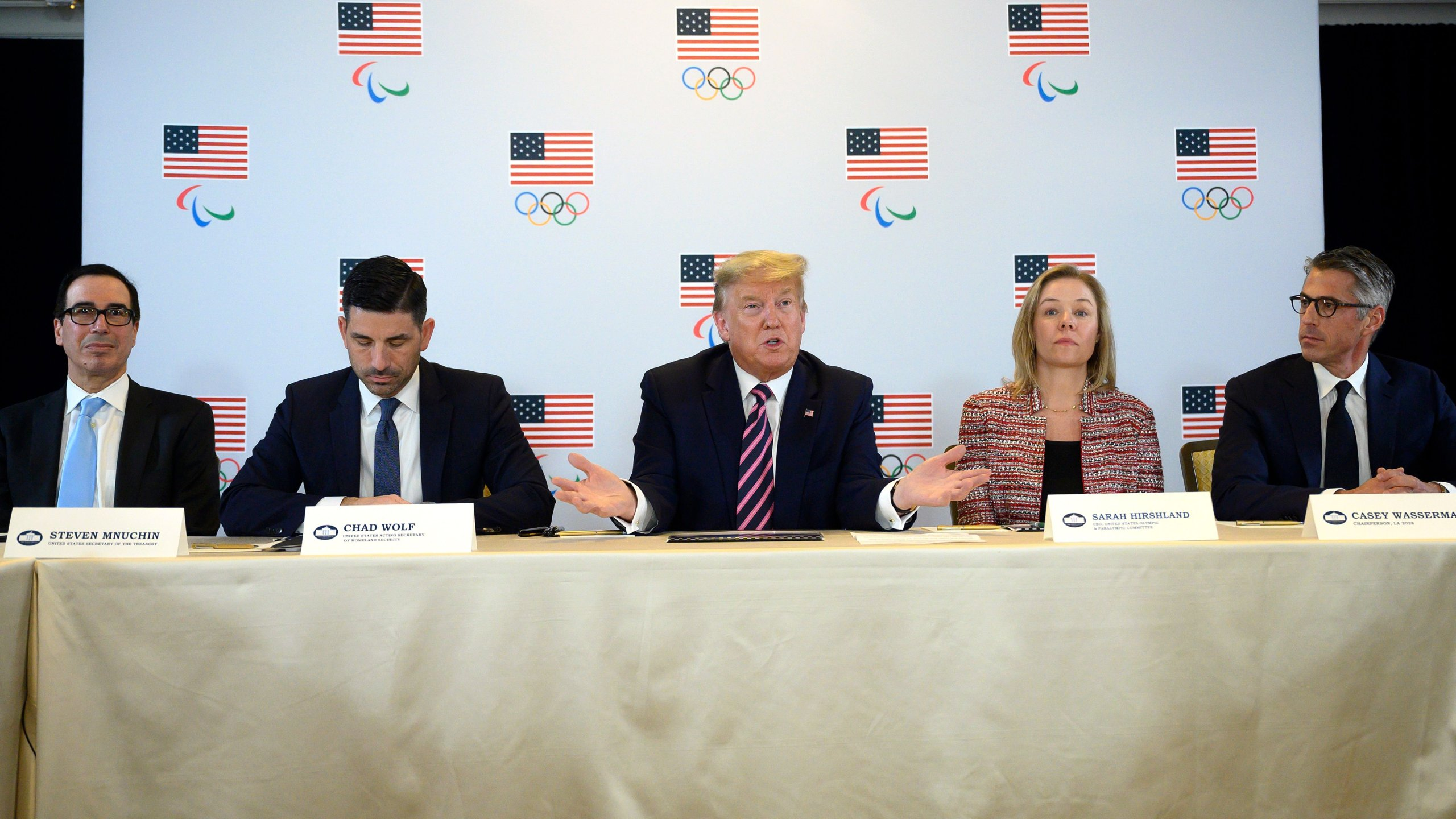 Treasury Secretary Steven Mnuchin, Acting Homeland Security Secretary Chad Wolf, US President Donald Trump, US Olympic & Paralympic Committee CEO Sarah Hirshland and Chairman of LA 2028 Casey Wasserman participate in a briefing with the US Olympic and Paralympic Committee and LA 2028 Organizers in Beverly Hills on Feb. 18, 2020. (Credit: JIM WATSON/AFP via Getty Images)