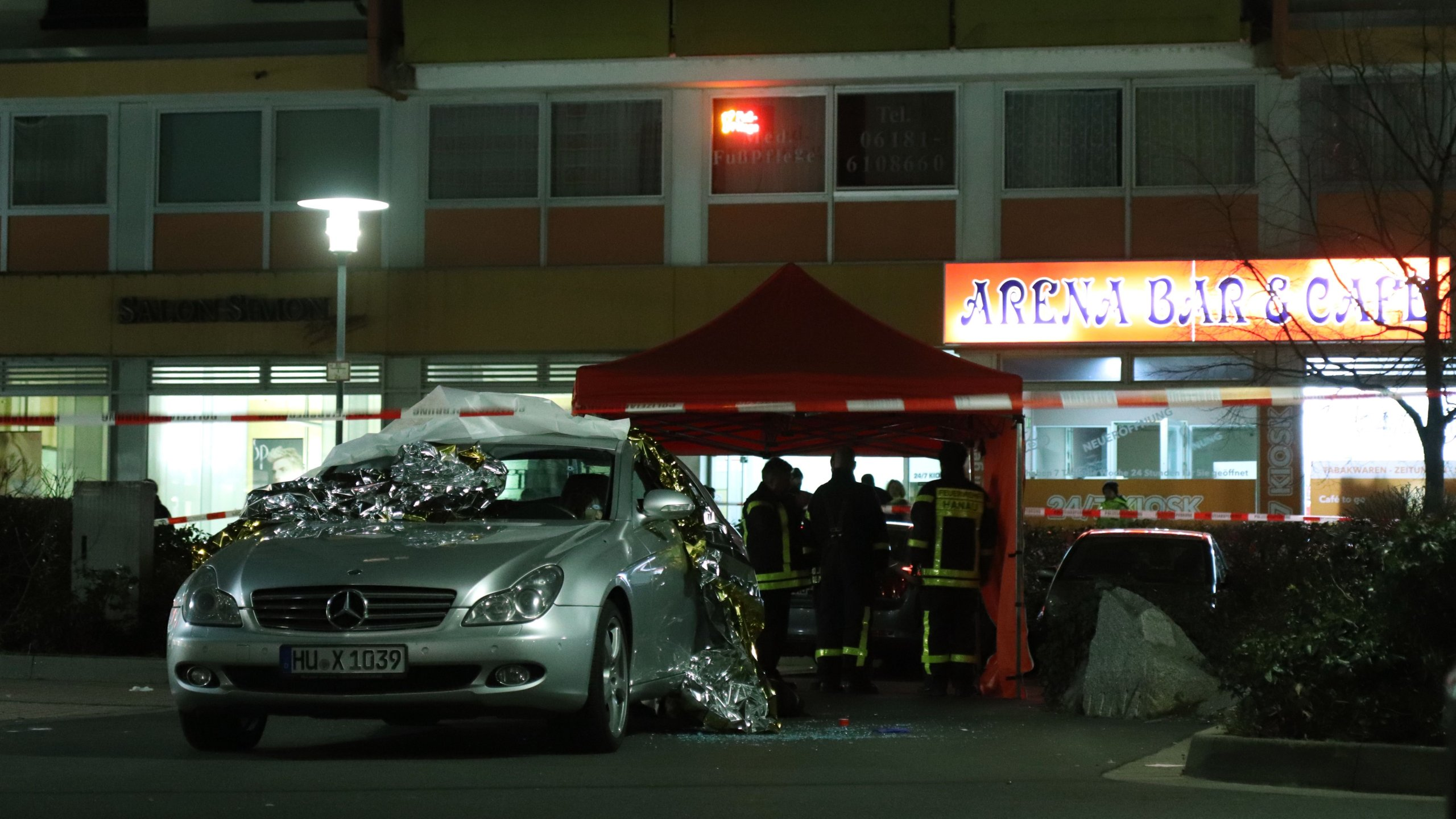 Emergency services work at the scene of the shooting in Hanau, western Germany, on Feb. 20, 2020. (Credit: YANN SCHREIBER/AFP via Getty Images)