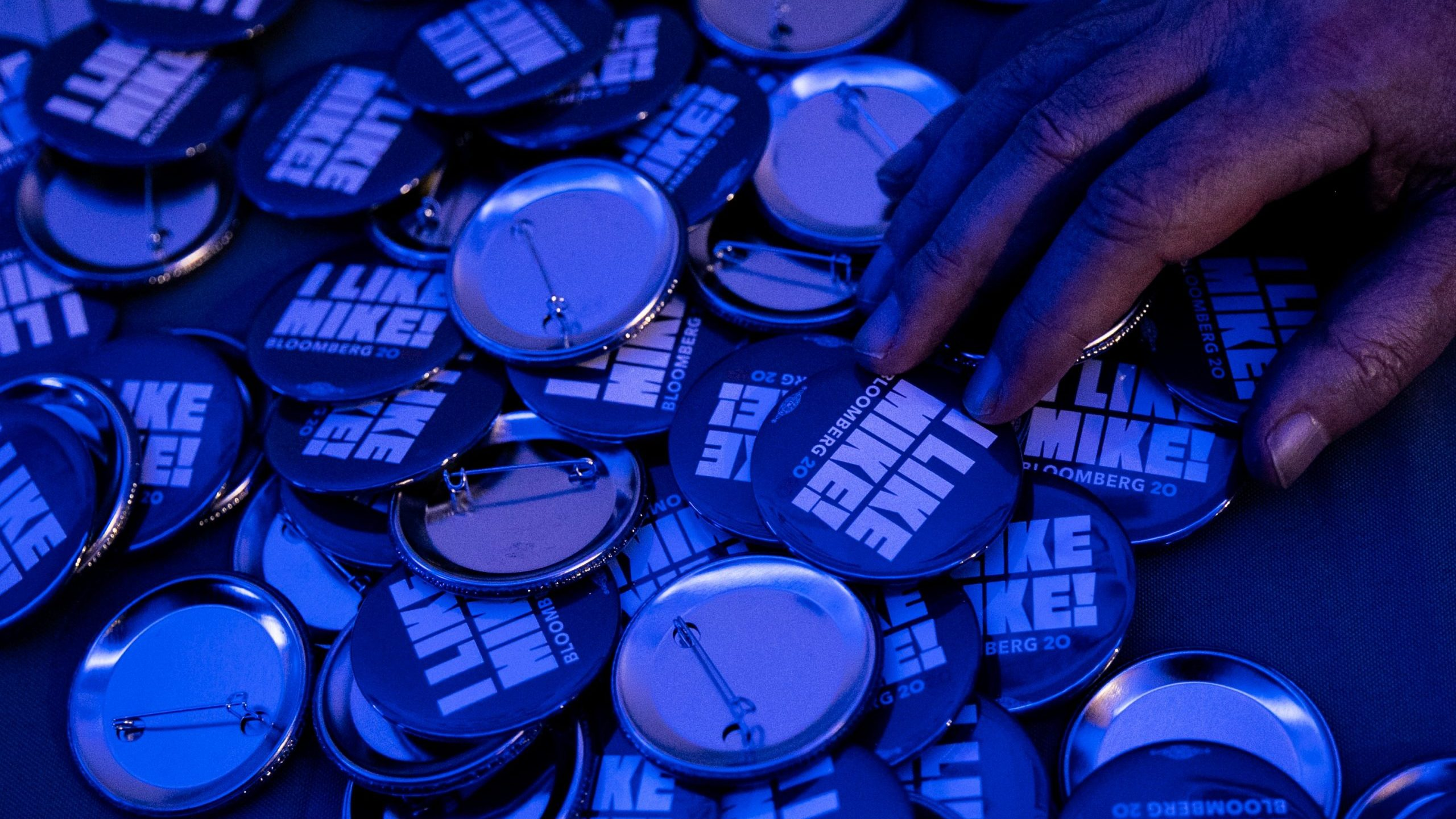 Mike Bloomberg 2020 campaign pins are seen during a debate watch party at Brooklyn field office on Feb. 19, 2020, in New York City. (Credit: Jeenah Moon/Getty Images)