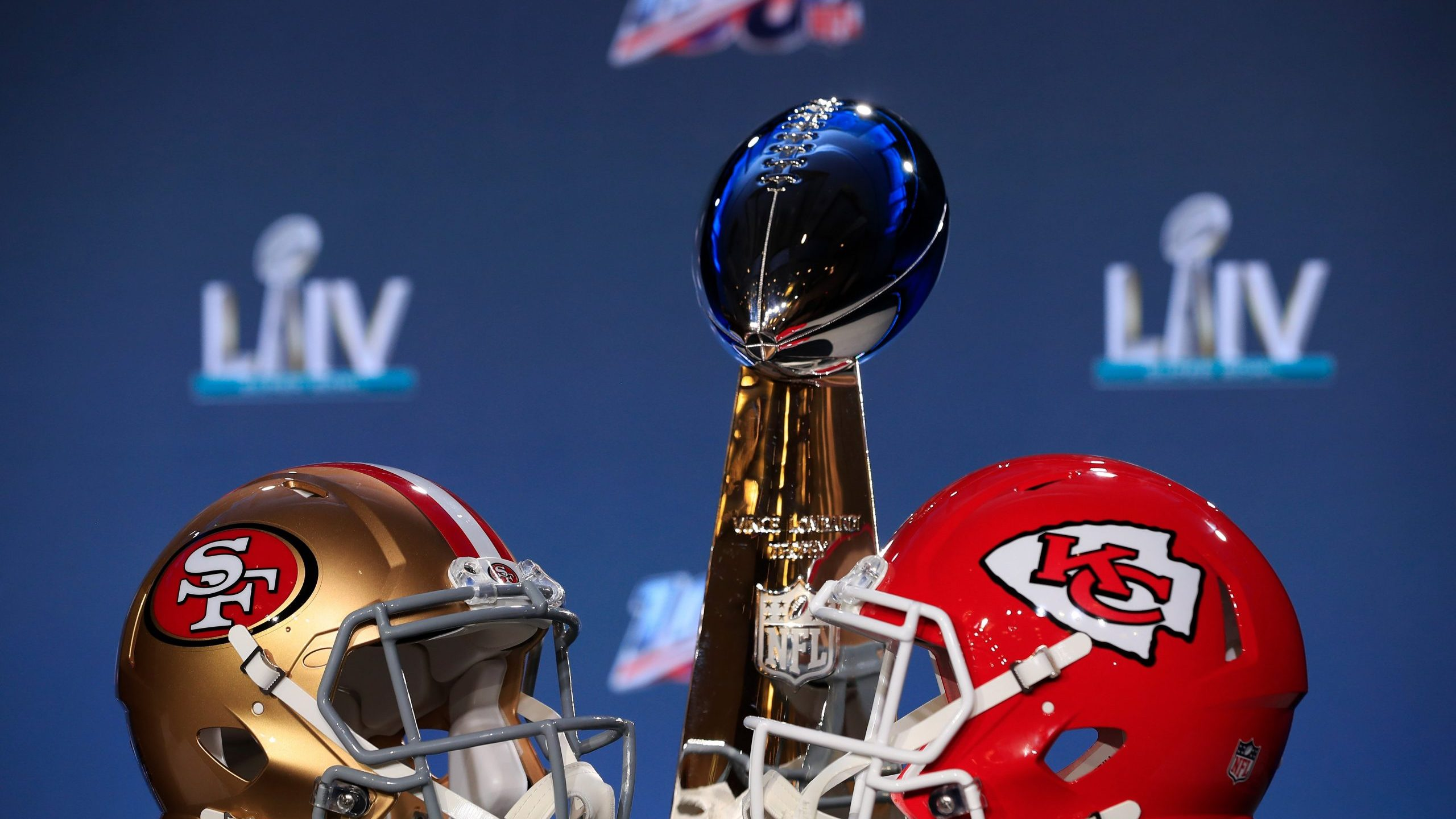 The Vince Lombardi Trophy is displayed with helmets of the San Francisco 49ers and Kansas City Chiefs at the Hilton Miami Downtown on Jan. 29, 2020 in Miami, Florida. (Credit: Cliff Hawkins/Getty Images)