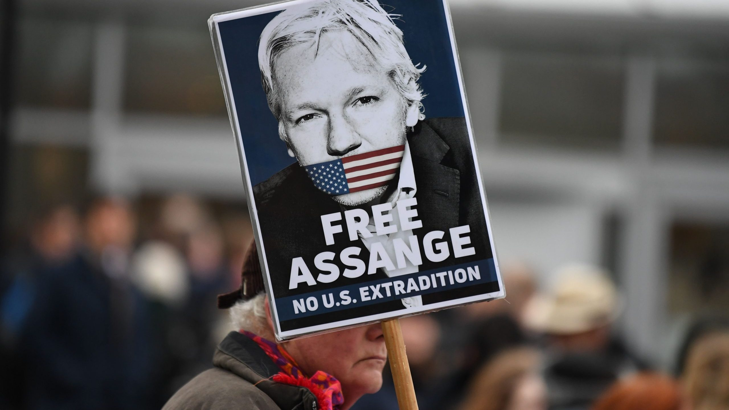 A supporter of WikiLeaks founder Julian Assange holds a placard calling for his freedom outside Woolwich Crown Court and HMP Belmarsh prison in southeast London on Feb. 24, 2020, ahead of the opening of the trial to hear a U.S. request for Assange's extradition. (Credit: DANIEL LEAL-OLIVAS/AFP via Getty Images)