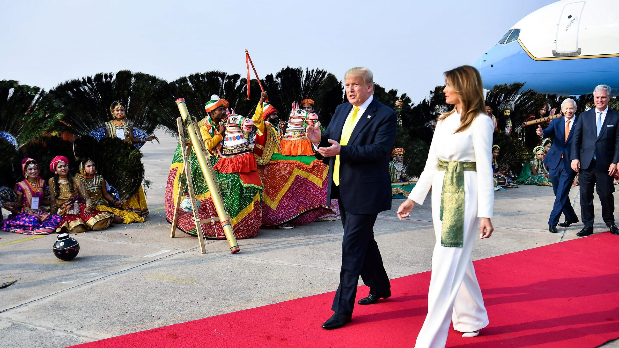 Donald Trump and First Lady Melania Trump are greeted by performers wearing traditional costumes as they arrive at Agra Air Base in Agra on Feb. 24, 2020. (Credit: MANDEL NGAN/AFP via Getty Images)