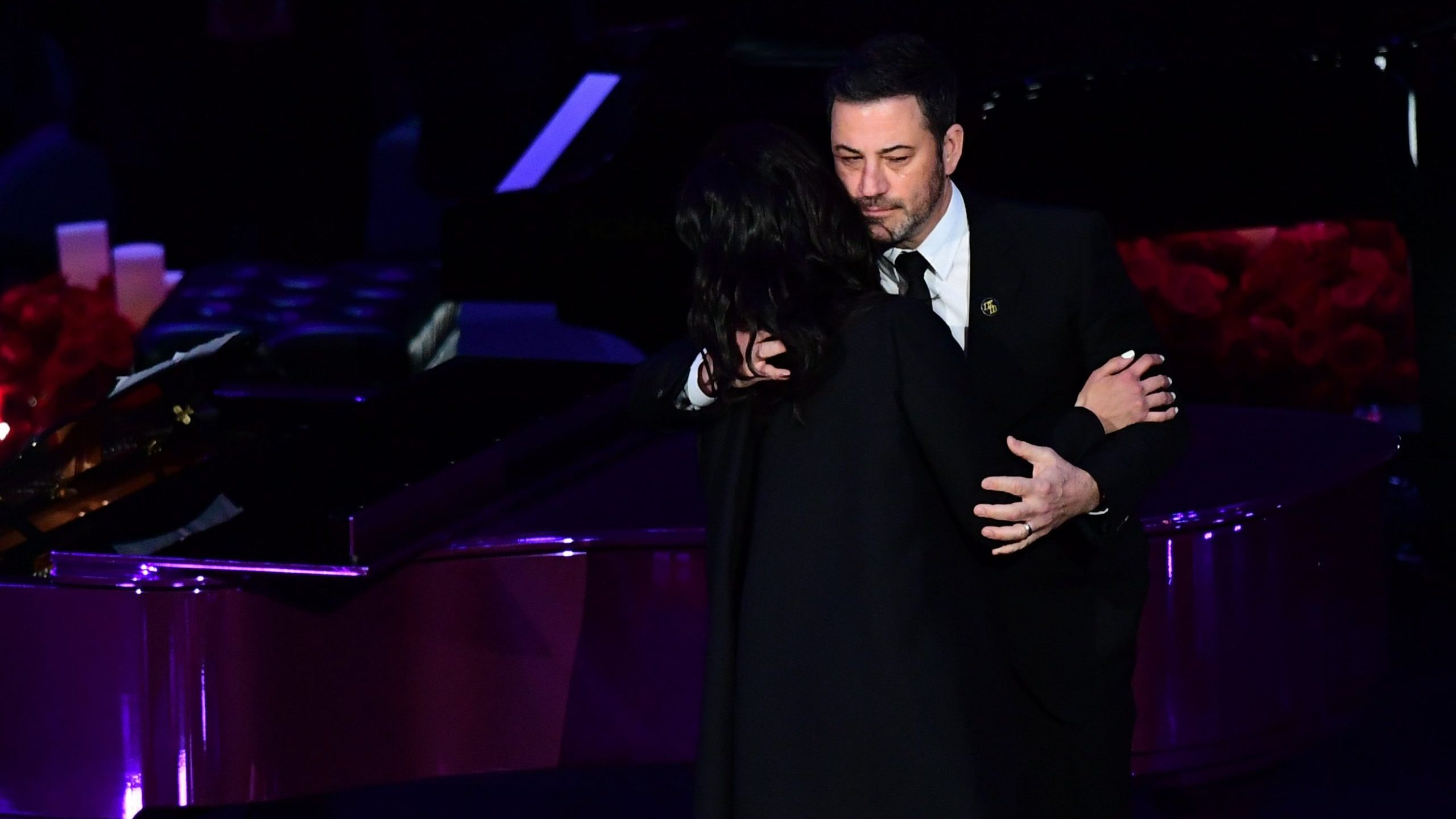 "Kobe Bryant's wife Vanessa Bryant (L) hugs television host Jimmy Kimmel as she arrives to speak during the ""Celebration of Life for Kobe and Gianna Bryant"" service at Staples Center in Downtown Los Angeles on Feb. 24, 2020. (Credit: Frederic J. Brown/ AFP)"
