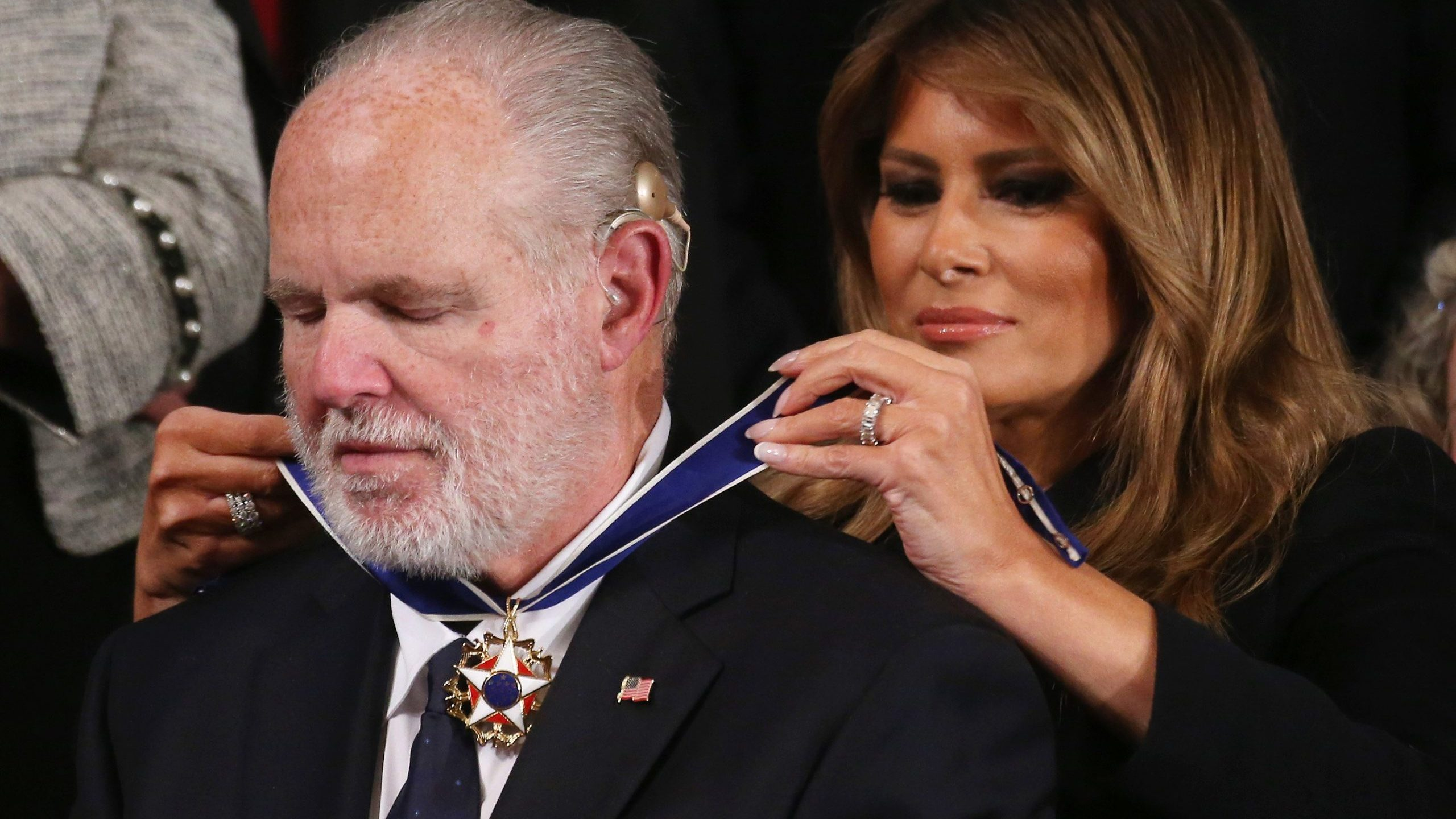 Radio personality Rush Limbaugh reacts as first lady Melania Trump gives him the Presidential Medal of Freedom during the State of the Union address on Feb. 4, 2020. (Credit: Mario Tama / Getty Images)