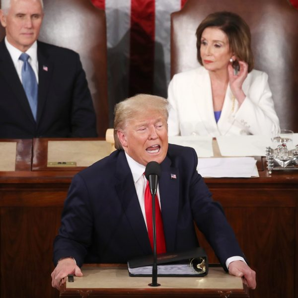 President Donald Trump delivers the State of the Union address as House Speaker Nancy Pelosi and Vice President Mike Pence look on, Feb. 4, 2020. (Credit: Mark Wilson / Getty Images)