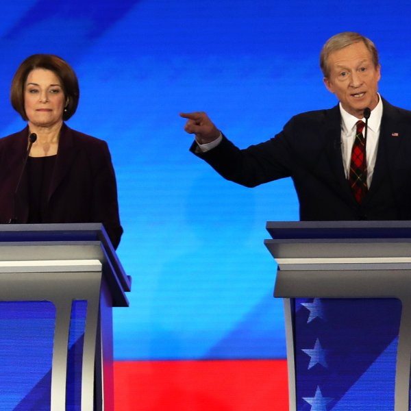Democratic presidential candidates Sen. Amy Klobuchar (D-MN) and Tom Steyer participate in the Democratic presidential primary debate in the Sullivan Arena at St. Anselm College on Feb. 7, 2020, in Manchester, New Hampshire. (Credit: Joe Raedle/Getty Images)